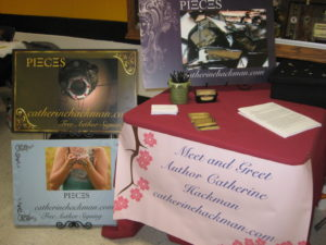 "This is a table I set up to promote my free online story, ""Pieces."" You can read it by clicking on the tabs above."